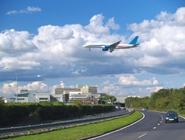 Aircraft Landing at London's Gatwick Airport. Showing the South terminal and road tunnel.