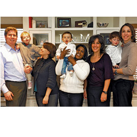 Amy Selco (third from left) with her husband, Kevin Keeley, and their son, Noah; Leslie Bellavia (third from right) with her partner, Meg Cortezi (far