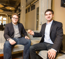 Andrew Sowers '15 (left) and Austin Shoecraft '14 in the Rev offices in downtown Ithaca. Photo by Adam Baker
