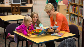 Anna Gardner, class of 2019, reading stories with Kids at the Annual Tompkins County Read-a-thon at the Public Library