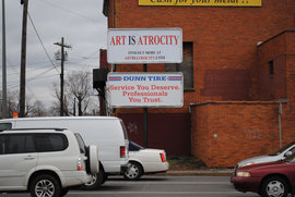 Art is Atrocity billboard in Syracuse
