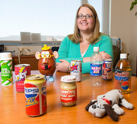 Assistant Professor Alison Shields with some of her collection of offbeat products. Photo by Adam Baker