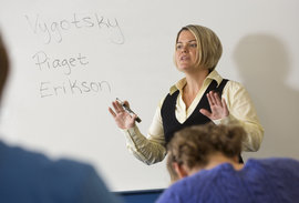 Assistant Professor Laura Campbell lectures to a classroom of students.