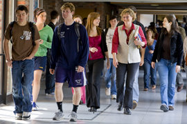 Associate Professor Brooke Hansen walks with students. Photo by Bill Truslow