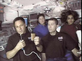Astronaut Ilan Ramon shows a miniature Torah scroll he carried into space aboard the Space Shuttle Columbia.