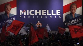 Bachelet and her supporters (AP Photo/Luis Hidalgo)