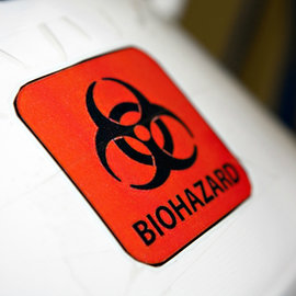 Biohazard symbol on a white cannister