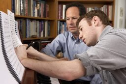 Brett and Greg Woodward at the piano