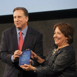 Bruce Beck '78 receives the Jessica Savitch Award for Excellence in Journalism from Diane Gayeski, dean of the Roy H. Park School of Communications. (