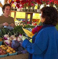 Buying fresh veggies at the Ithaca Farmers' Market
