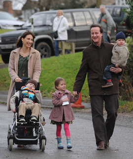 Cameron walking through Chadlington, near his Oxfordshire home, with his wife and children (December 27, 2007). Photograph: Stefan Rousseau/PA