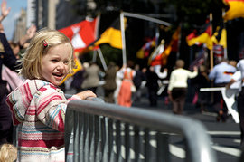 Child watching a parade route