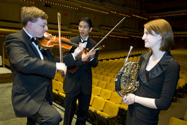 Chris Jones '08, Brian Hwang '08, and Elizabeth Teucke '10 on stage at Lincoln Center