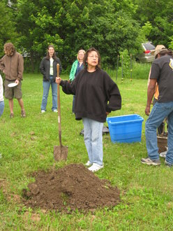Clanmother Birdie Hill planting peach tree at Cayuga Nation Picnic 2009