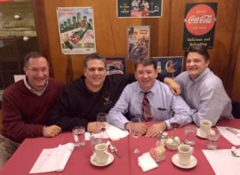 Class of '84 alumni and long-time friends (from left) Chris Didio, Alex Orlando, Dan Gilheney, and Charlie Colligan in 2014. Photo provided.
