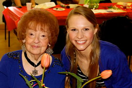 Co-president Mary Claire Hartford bonds with a Project Generations elder.