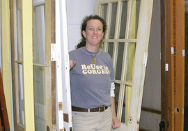 Cohen in the rapidly-filling warehouse at Finger Lakes ReUse; below, IC cottage she and staff deconstructed.   Photo above by George Sapio