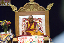 Dalai Lama onstage in Ben Light Gymnasium