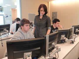 Danielle Puleo '14, assisting a student in the Business Systems and Technology course