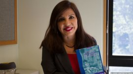 Dr. Giovanna Rivero with her recent book, which received special recognition from the Bolivian Academy of Children's and Young Adult Literature. Photo