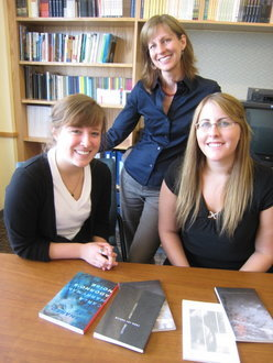 Editor Catherine Taylor (standing) with spring 2009 Essay Press interns Lauren Hesse & Fiana Muhlberger