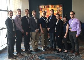 Eight of Professor Jason Muenzen's students spent a day with alumnus Jeff Bush '10 (fifth from left) at Koch Industries. Photo submitted.