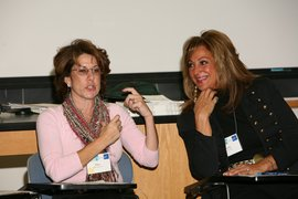 Ellen Israel '79 and Debbi Nigro '79 speak in a Jewish studies class.