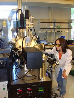 Emily Backus '12 growing a superconducting sample using a pulsed laser deposition system