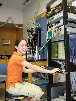 Emily Backus works on the data acqusition program for the cryocooler.
