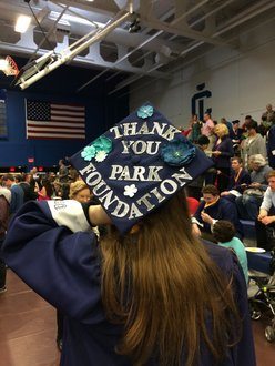 "Emily Masters, Park Scholar Class of 2015, shows her graduation camp on which is written ""Thank You Park Foundation!"""
