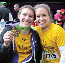 Erin Michael '05 (right) with a patient after the Baltimore Running Festival.