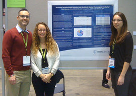 Faculty member Skott Freedman (left) and students Meredith Gennaro (middle) and Amanda DiTomaso presented a poster together at ASHA.