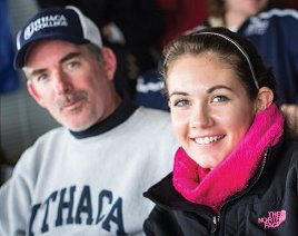 Father, wearing an Ithaca College sweatshirt, and daughter, who's an IC student