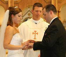 Father Joe Fitzgerald '93 at the wedding of Lauren Avellino '04 and Jason Macy '03