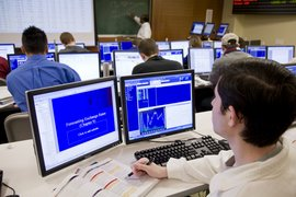 Finance students working in the trading room.