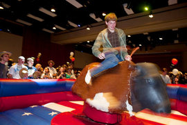 First-year exploratory major Dan Tappan hangs on tight at IC After Dark's Urban Cowboy event. Photo by Mike Grippi '10