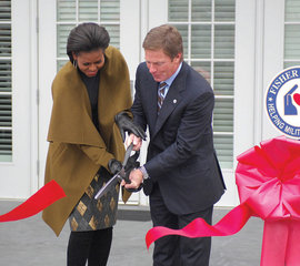 First lady Michelle Obama and Ken Fisher open a new Fisher house in Maryland in 2010 | Photo by Cat Debinder