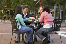 Four IC students at a table on the Commons
