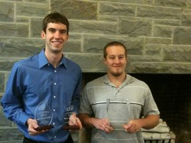 Gavin Cote '12 and Nathan March '11 display their awards