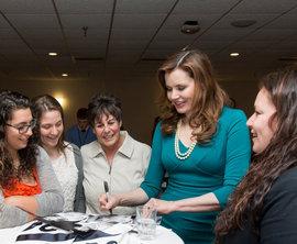 Geena Davis meets with Coach Deb Pallozzi and members of the women's softball team. Photo by Sheryl Sinkow