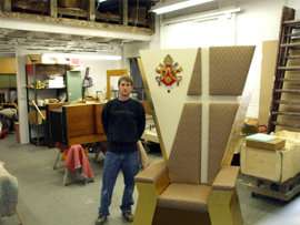 Glenn in his workshop with his papal throne
