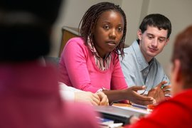 Graduate students engage in group discussion