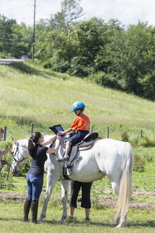 Horses and iPads help Strides© program participants communicate.