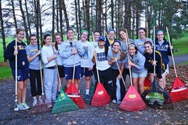 IC Women's Lacrosse volunteering with the Groton Community Association