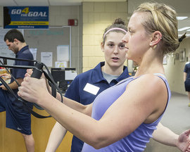 IC employee works with student trainer.