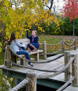 IC students relax by the pond at the chapel