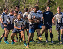 IC's men's club rugby team celebrates qualifying for Nationals. Photo by Annemarie Farrell