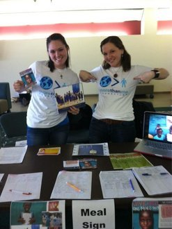 IMC's Victoria Probert (right) and CMD's Grace Schroeder Tabling Outside Emerson Suites for the More Than Me Foundation
