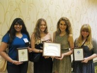 In photo, from left: Ithacan staff members Noreyana Fernando, Marianna Dunbrook, Megan Devlin and Evin Billington hold the Pacemaker awards.