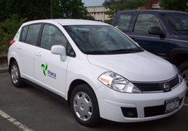 Ithaca Carshare Nissan Versa sits in its own reserved spot by the Park Center; photo by Andy Goodell/Ithaca Carshare